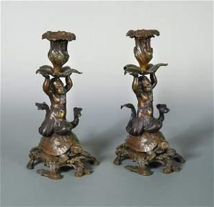 A pair of 19th century bronze candlesticks,