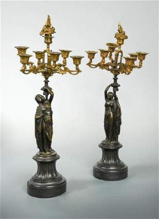 A pair of 19th century French bronze and parcel gilt