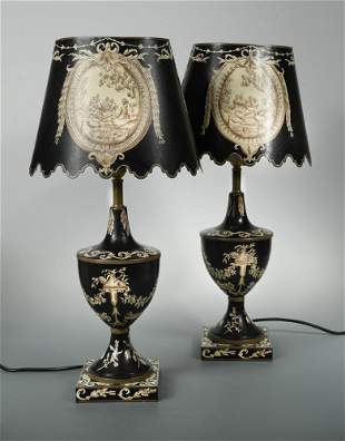 A pair of modern toleware table lamps and shades,