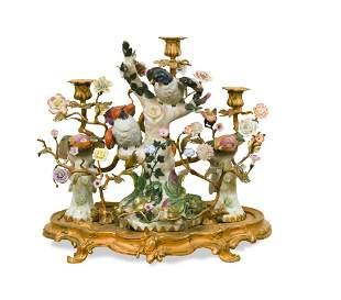 A decorative gilt bronze mounted porcelain candelabrum,