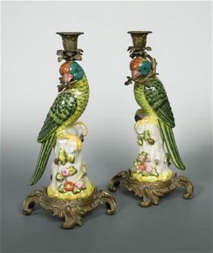 A pair of gilt metal mounted porcelain parrot