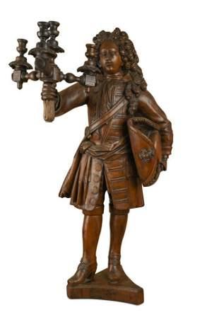 An Italian carved walnut figure in late 17th century