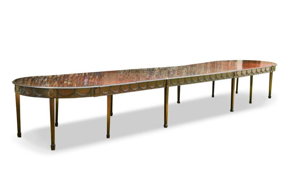 A 20th century Adam style mahogany D end dining table,