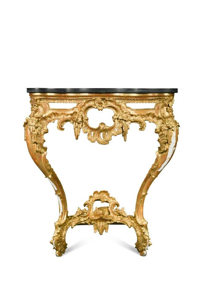 A George IV carved and pierced giltwood serpentine