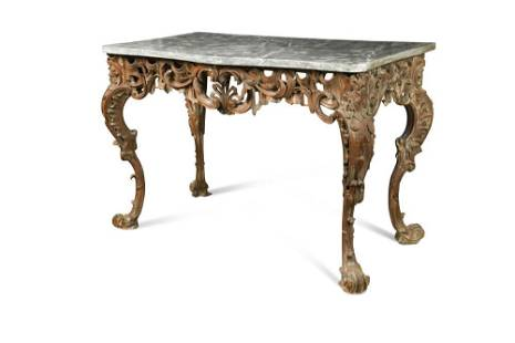 A George I carved pine wood serpentine console table,
