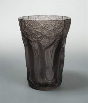 An early 20th century moulded amethyst glass vase