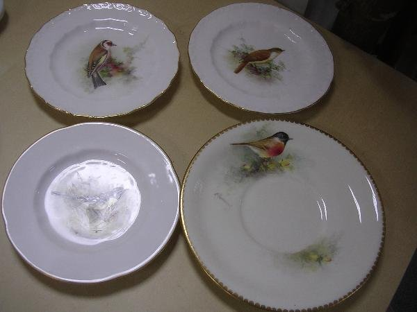 27: THREE ROYAL WORCESTER PLATES AND A SAUCER