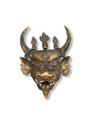 A Tibetan bronze mask of Dharmapala Yamantaka