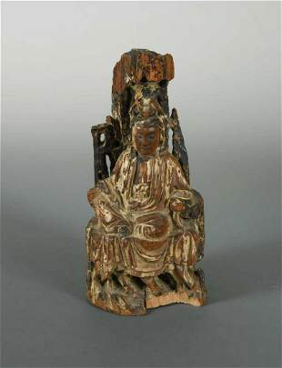 A Chinese carved wood figure of Guanyin Qing Dynasty