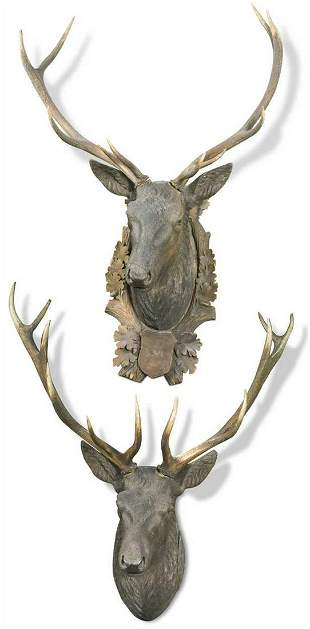 A near pair of Swiss (Brienz) carved wood stag's heads,