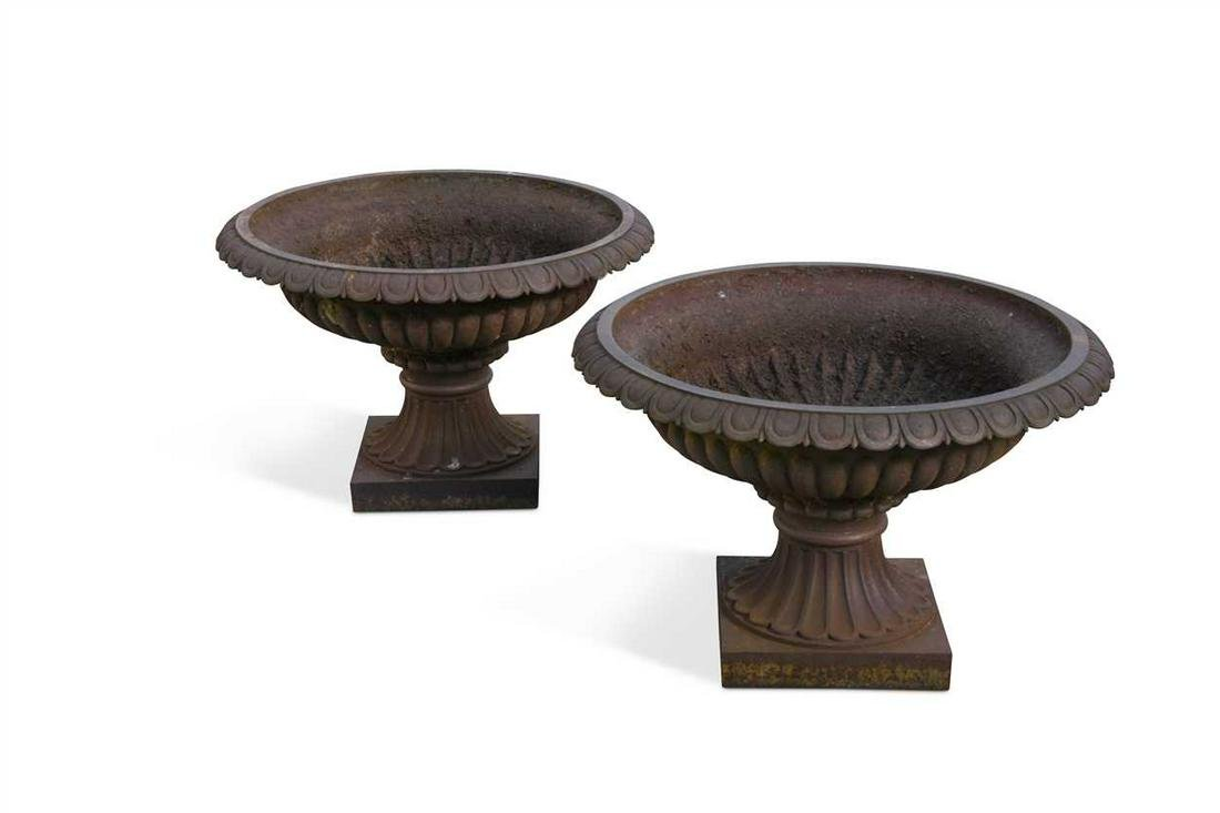 A pair of Victorian cast iron campagna urns,