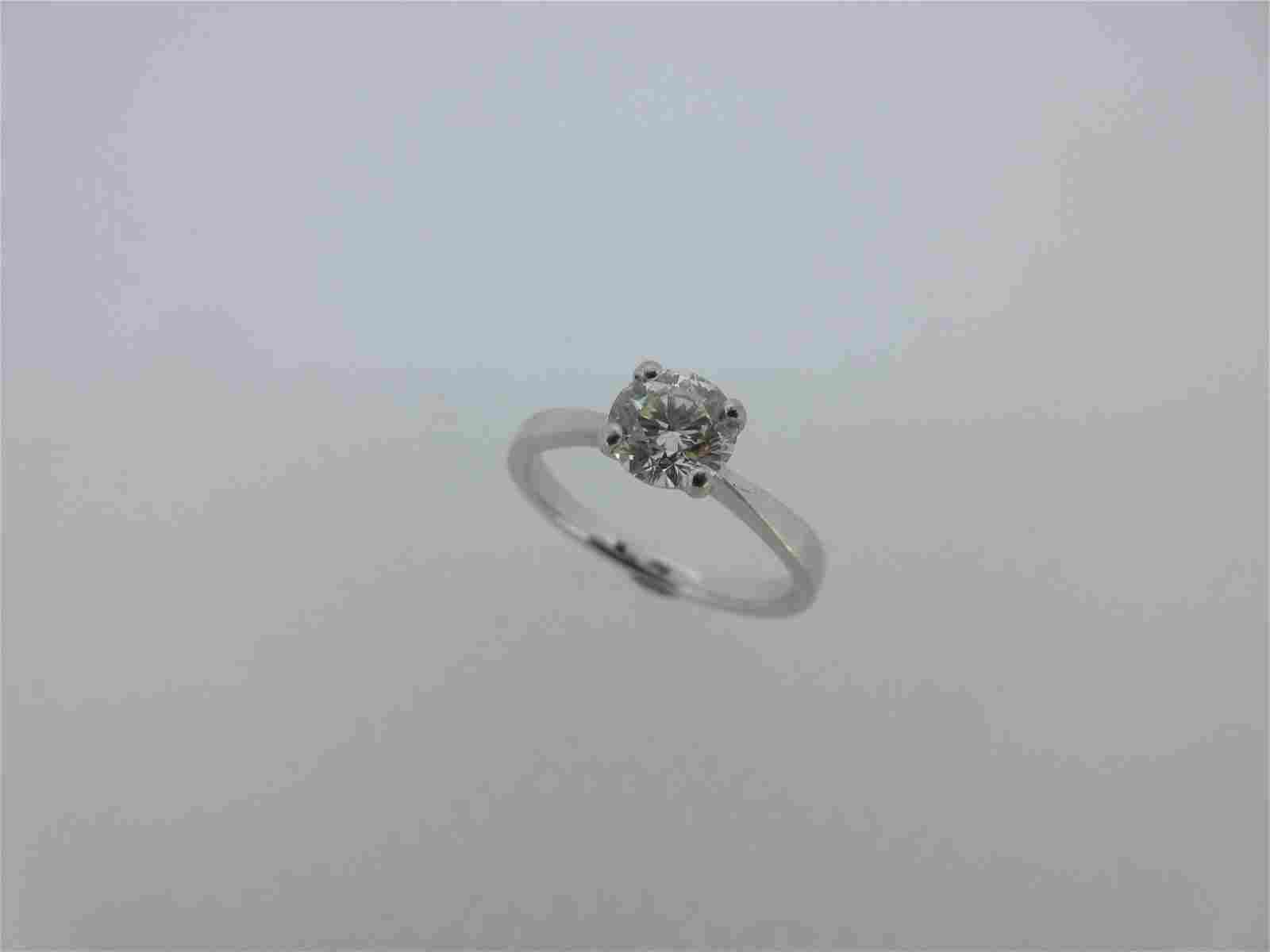 A single stone diamond ring set in platinum,