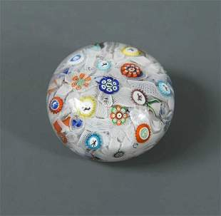 A Baccarat spaced millefiori paperweight, dated 1848,