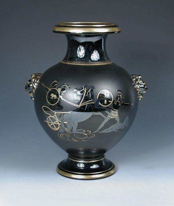 7: A BLACK VASE AND COVER