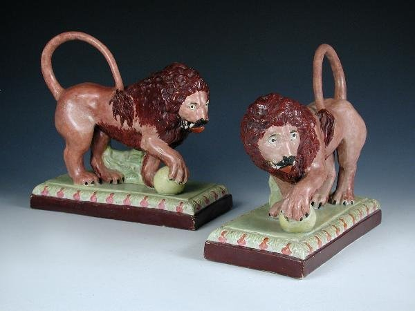 10: A PAIR OF STAFFORDSHIRE LIONS