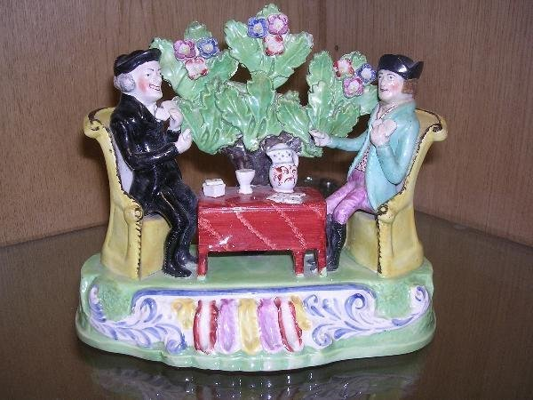 16: AN EARLY 19TH CENTURY STAFFORDSHIRE POTTERY GROUP
