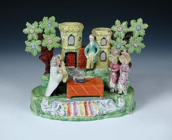 17: AN EARLY 19TH CENTURY STAFFORDSHIRE CHRISTENING