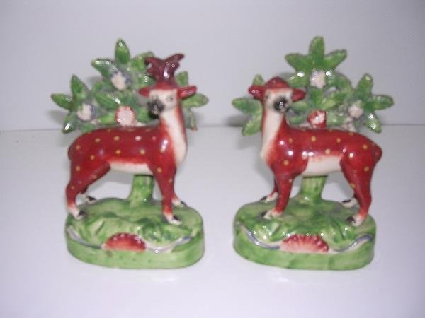 23: A PAIR OF EARLY 19TH CENTURY STANDING DEER BACKED