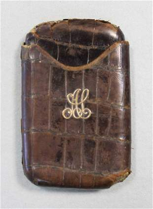 An early 20th century crocodile leather pocket cigar