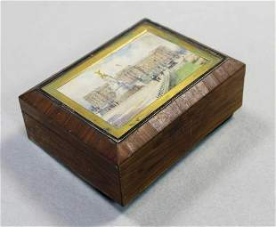 An early 20th century cigarette box the lid painted