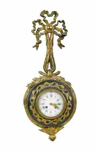 A Louis XVI style 8 day gilt metal and bronzed cartel