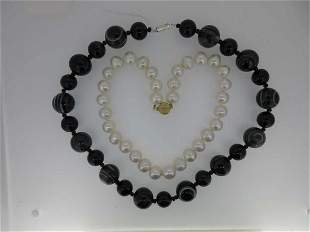 A row of uniform pearls together with a banded agate