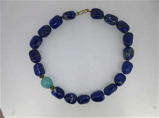 A necklace of large lapis lazuli beads and one