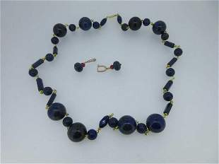 A row of lapis lazuli beads together with a pair of
