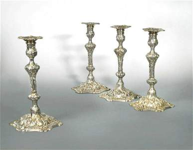 A set of 4 George III cast silver candlesticks,