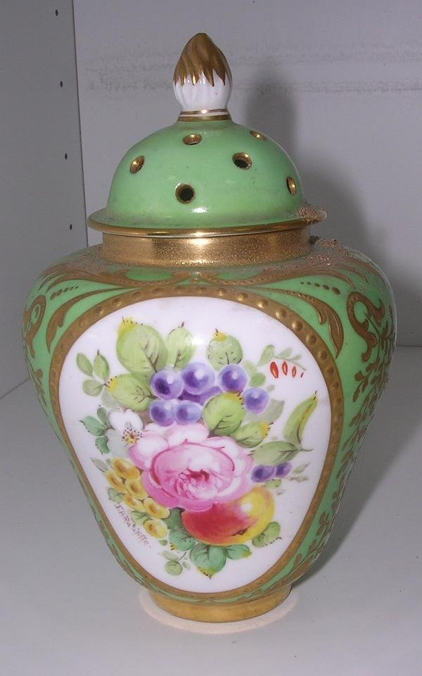 25: A DERBY APPLE GREEN GLAZED MINIATURE VASE AND