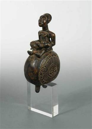"""A Yombe (or Mayombe) carved wood """"Dibuâ€, figural"""
