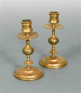 A pair of Toledo Ware candlesticks probably 19th