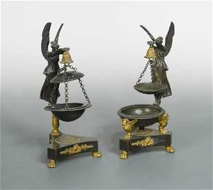 A pair of Regency bronze parfumiers,