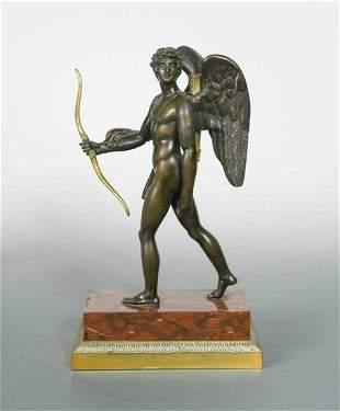 A 19th century bronze and gilt bronze model of Eros,