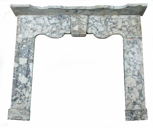 684: AN 18TH CENTURY BRECCIA MARBLE CHIMNEY PIECE IN TE