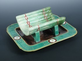 A Mintons majolica asparagus tray, date symbol for 1877