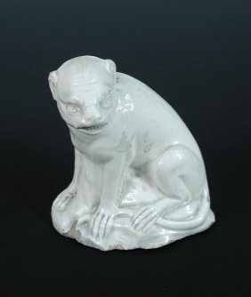 A late 18th century white pearl ware monkey,