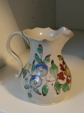 A mid 18th century white saltglaze jug