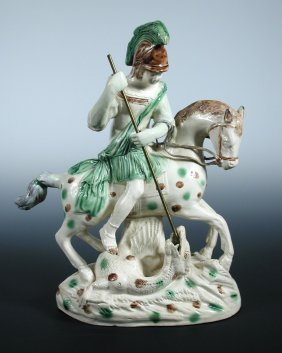 A late 18th century Whieldon type cream ware George and