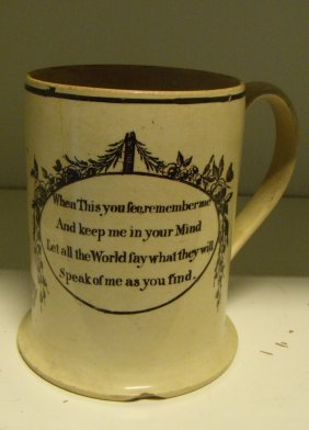 A late 18th/early 19th century creamware mug, possibly