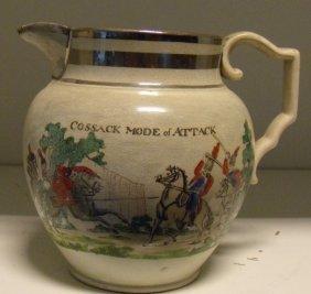 An early 19th century pearl ware satirical jug,