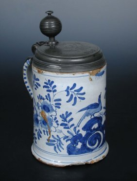 An 18th century Delft blue and white tankard, possibly