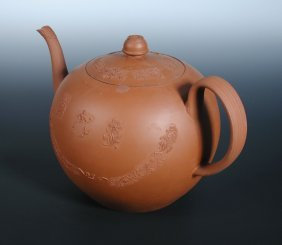 A mid 18th century Staffordshire red ware punch pot and