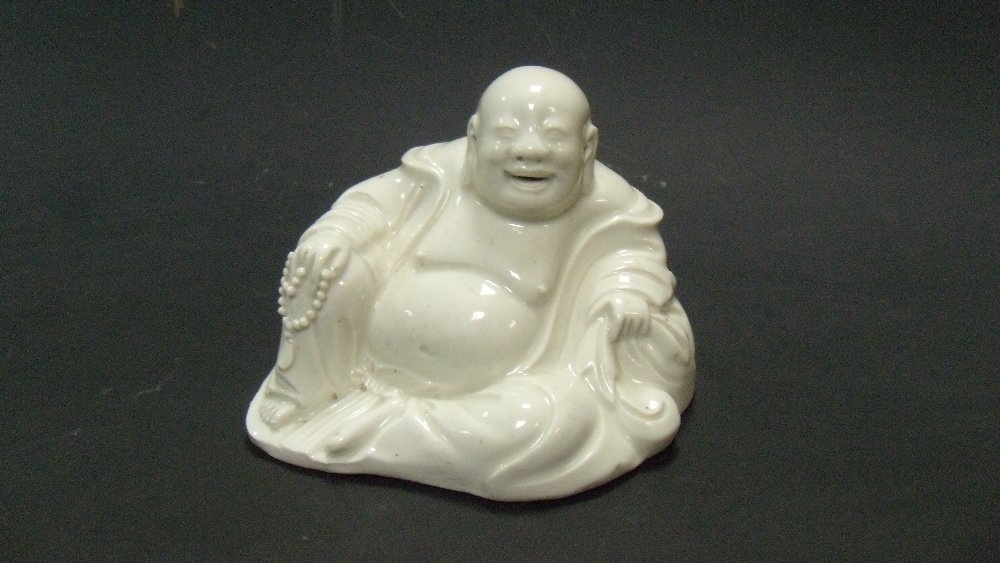 A late 19th century blanc de Chine figure of Budai,