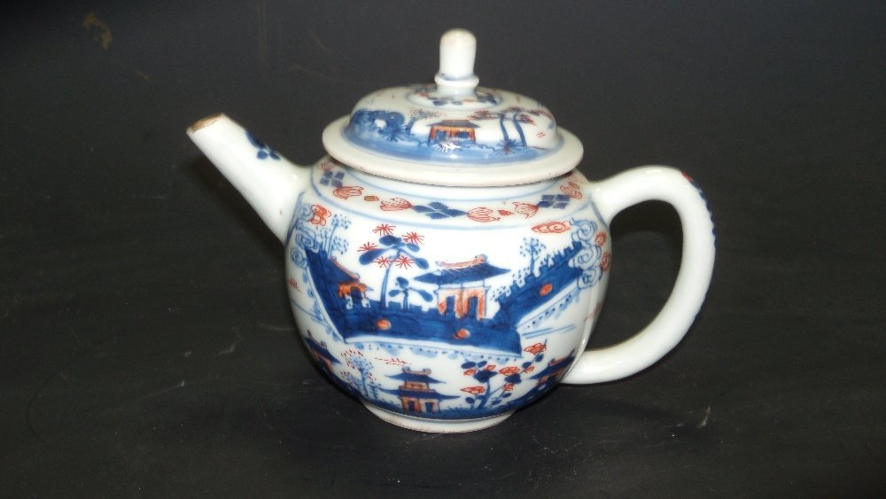 An 18th century Imari palette tea pot and cover,