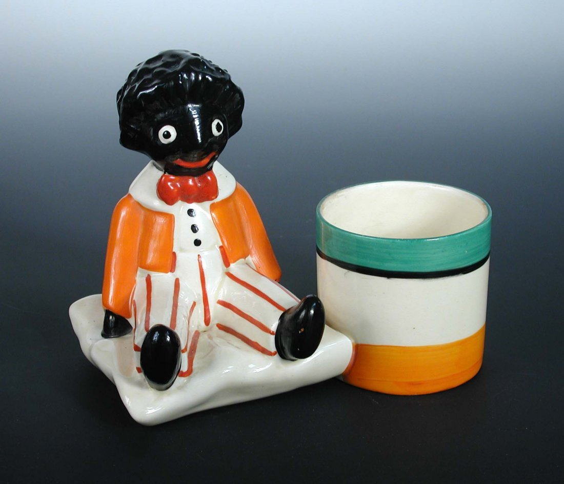 A Clarice Cliff Golly pencil holder,