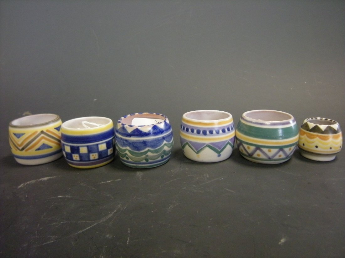 A collection of five Poole Pottery egg cups,