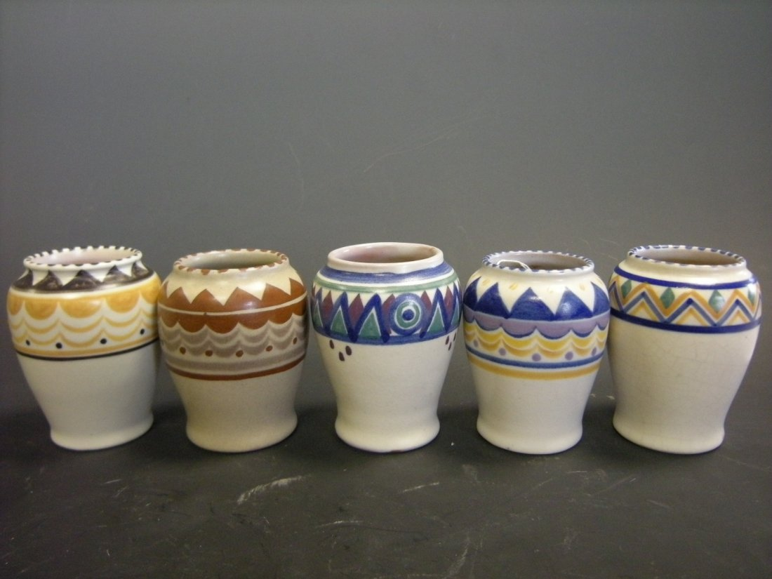 A collection of five small Poole Pottery vases, circa 1