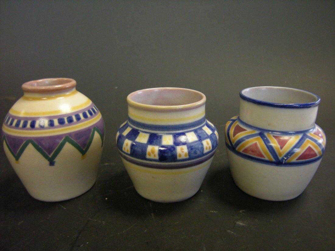Three small Poole Pottery vases,