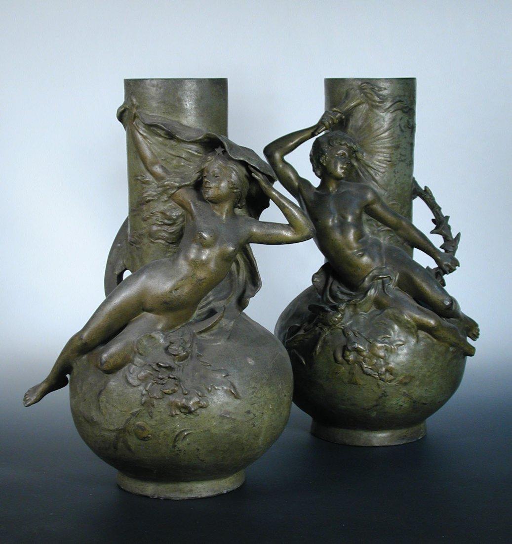 A large pair of Art Nouveau figural bronzed vases,